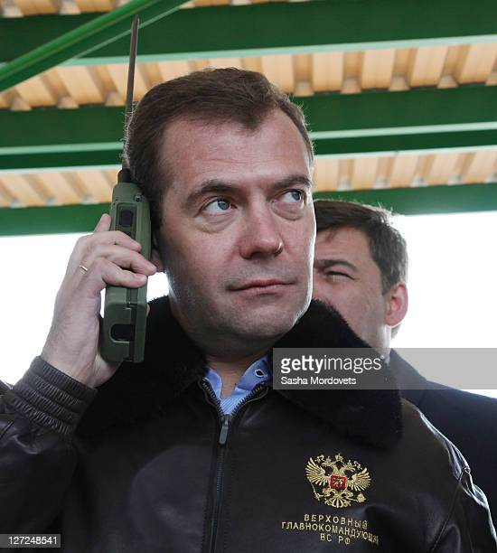 Russian President Dmitry Medvedev uses a new radio while attending military exercises at a polygon September 27 2011 in Chebarkul Chelyabinks region...