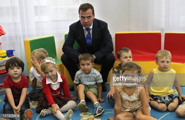 Russian President Dmitry Medvedev visits children in a kindergarten on August 18 2011 in Maykop Republic of Adygea Russia Medvedev and Prime Minister...