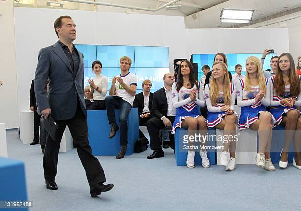 Russian President Dmitry Medvedev walks past a group of Medvedev supoorters called 'Medvedev girls' as he arrives to give a speech during his meeting...