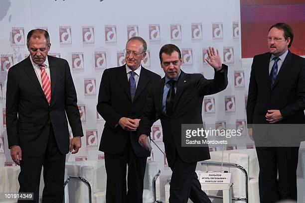 Russian President Dmitry Medvedev waves as he arrives for an international forum on counteracting drug production in Afghanistan, as Russian Foreign...