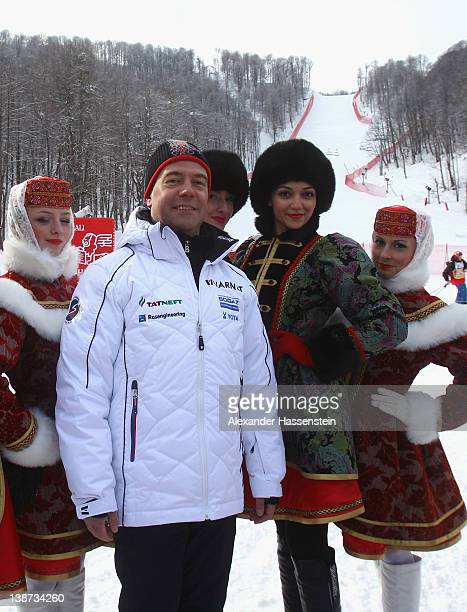 Russian president Dmitry Medvedev with flower bearers after the Men's Downhill at the Audi FIS World Cup on February 11 at Rosa Khutor Mountain...