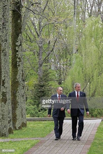Russian President elect Dimitry Medvedev and US President George W Bush talk during a bilateral meeting at the President's summer retreat Docharov...