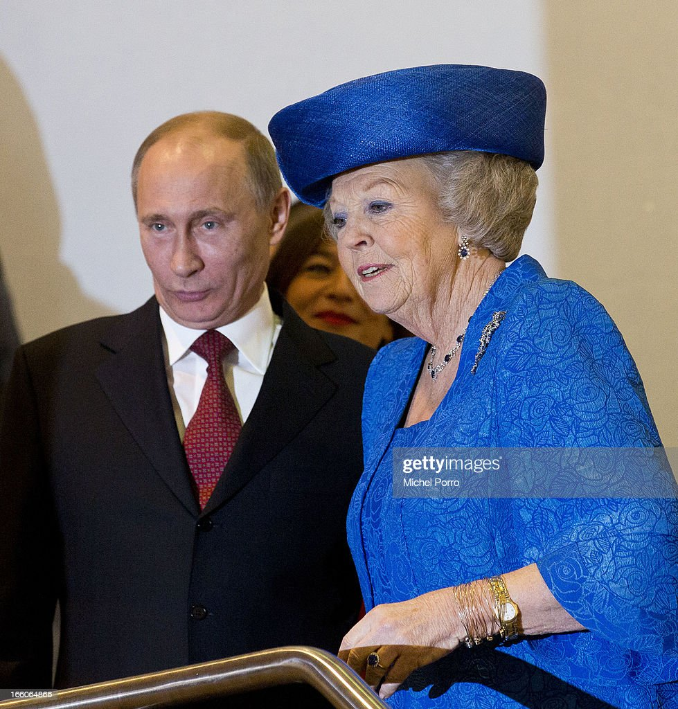 Russian President Putin and Queen Beatrix of The Netherlands attend Tsar Peter Exhibition on April 8, 2013 in Amsterdam, Netherlands. Putin began a one-day state visit to the Netherlands at the invitation of Queen Beatrix.