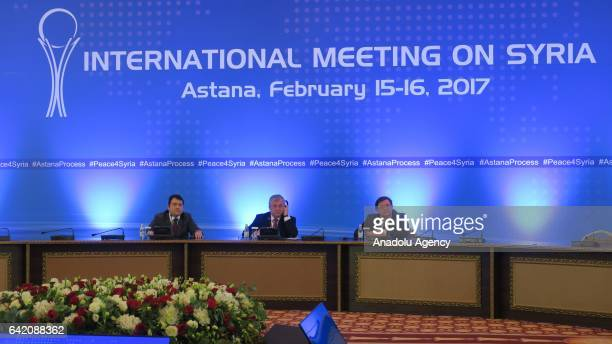 Russian President Putin's special envoy to Syria Alexander Lavrentiev listens to the translation during the third session of Syria peace talks in...