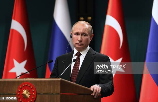Russian President Vladimir holds a joint press conference with the Turkish President after their meeting at the Presidential Complex in Ankara on...