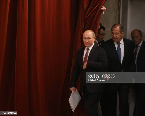 Russian President Vladimir Puti enters the hall as Foreign Affairs Minister Sergei Lavrov looks on during his annual meeting with ambassadors...