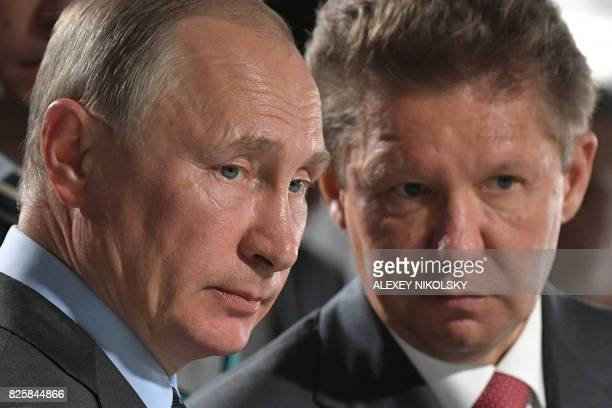 Russian President Vladimir Putin accompanied by Gazprom Chief Executive Officer Alexei Miller visits the construction site of the Amur gas processing...
