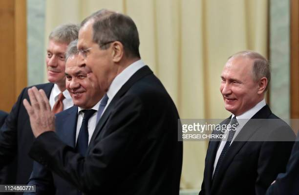 Russian President Vladimir Putin , accompanied by Kremlin spokesman Dmitry Peskov , Defence Minister Sergei Shoigu and Foreign Minister Sergei Lavrov...