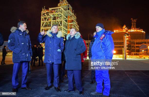 Russian President Vladimir Putin accompanied by Novatek chief Leonid Mikhelson and Russia's energy minister Alexander Novak visits under construction...