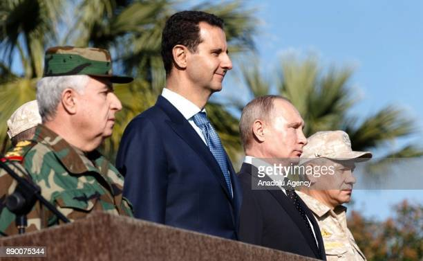 Russian President Vladimir Putin accompanied by President of Syria Bashar alAssad visits the Hmeymim base in Syria's Latakia on December 11 2017