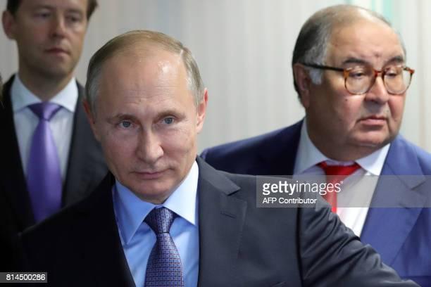 Russian President Vladimir Putin accompanied by Trade and Industry Minister Denis Manturov and billionaire Alisher Usmanov visits the Lebedinsky iron...