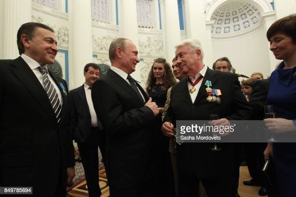 Russian President Vladimir Putin actor Vladimir Vinokur and billionaire Aras Agalarov seen during an awarding ceremony in the Kremlin in Moscow...