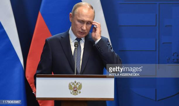 Russian President Vladimir Putin addresses a press conference with the Hungarian Prime Minister Viktor Orban at the residence of the prime minister...