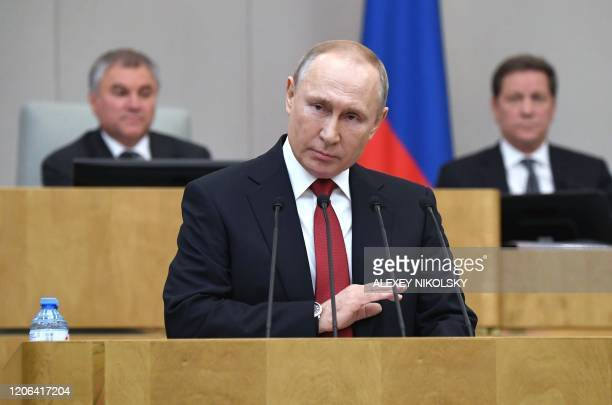 TOPSHOT Russian President Vladimir Putin addresses lawmakers debating on the second reading of the constitutional reform bill during a session of the...