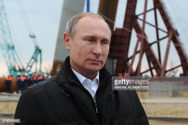 Russian President Vladimir Putin addresses people marking the second anniversary of Russia's annexation of the Black Sea peninsula in central Moscow...