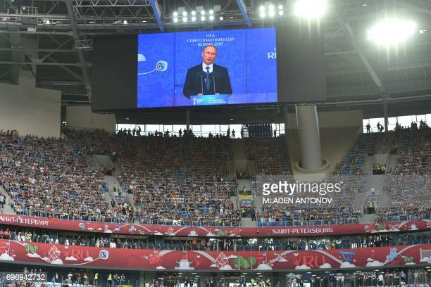 Russian President Vladimir Putin addresses the fans during the opening ceremony of the 2017 Confederations Cup group A football match between Russia...