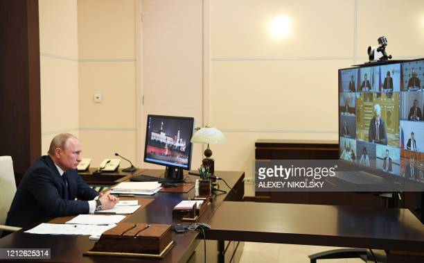 Russian President Vladimir Putin addresses the nation via teleconference at the NovoOgaryovo state residence outside Moscow on May 11 2020 President...