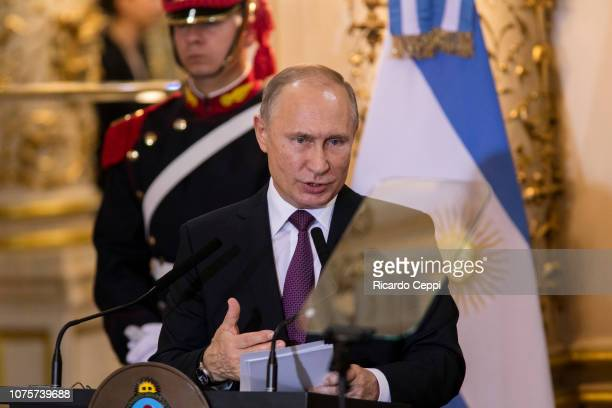 Russian President Vladimir Putin addresses the press after a meeting between the presidents of Argentina and Russian Federation as part of Argentina...