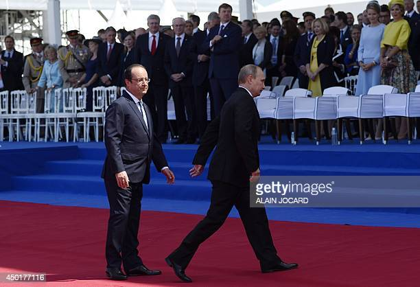Russian President Vladimir Putin after being welcomed by French President Francois Hollande during the international DDay commemoration ceremony in...