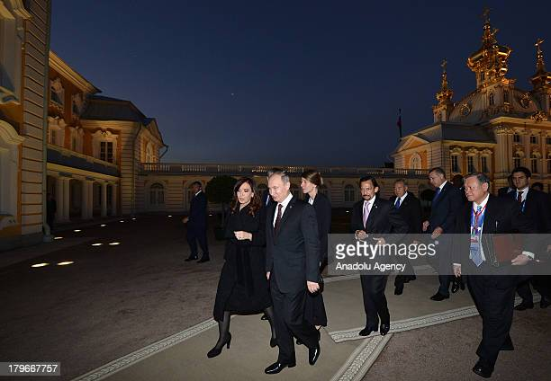 Russian President Vladimir Putin and Argentina's President Cristina Fernandez de Kirchner walk with other G-20 leaders for the dinner at the Peterhof...