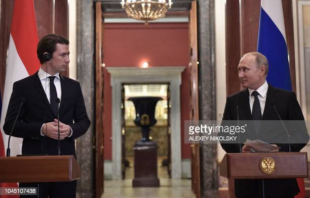 Russian President Vladimir Putin and Austrian Chancellor Sebastian Kurz give a press conference following their meeting at the State Hermitage Museum...