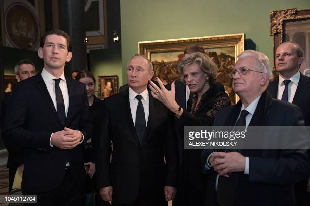 Russian President Vladimir Putin and Austrian Chancellor Sebastian Kurz take part in the opening ceremony of an art exhibition titled 'Imperial...