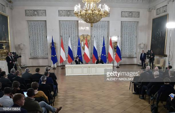 Russian President Vladimir Putin and Austrian Chancellor Sebastian Kurz attend a press conference following their meeting at the State Hermitage...