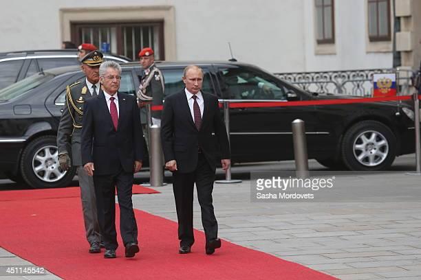 Russian President Vladimir Putin and Austrian President President Heinz Fischer attend a welcoming ceremony on June 24 2014 in Vienna Austria Putin...