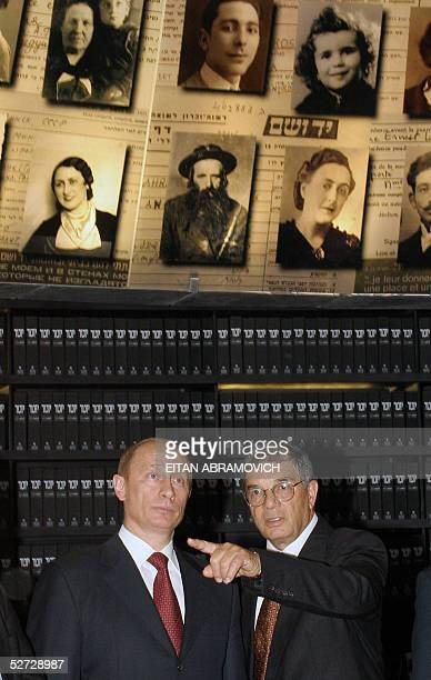 Russian President Vladimir Putin and Avner Shalev director of the Yad Vashem Holocaust Memorial Museum are seen under the conicalshaped roof of the...