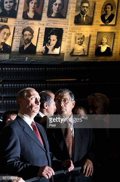 Russian President Vladimir Putin and Avner Shalev director of Yad Vashem stand in the Hall of Names at the Yad Vashem Holocaust Memorial Museum April...