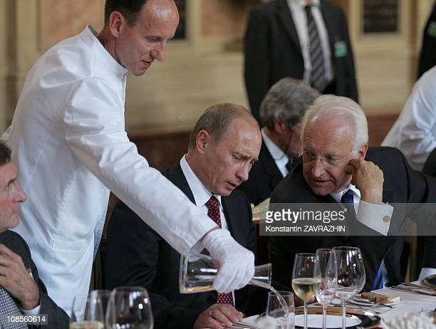 Russian President Vladimir Putin and Bavaria's premier Edmund Stoiber during a dinner visits MunichGermany on October 11 2006
