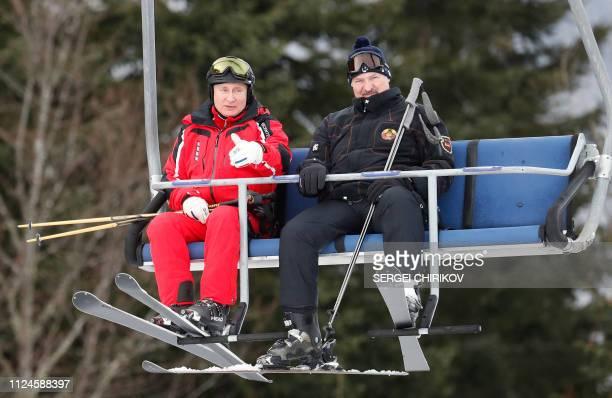 TOPSHOT Russian President Vladimir Putin and Belarus' President Alexander Lukashenko enjoy skiing at the Gazprom Mountain Resort in the Black sea...