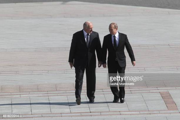 Russian President Vladimir Putin and Belarusian President Alexander Lukashenko arrive at the Great Patriotic War Museum on July 2 2014 in Minsk...