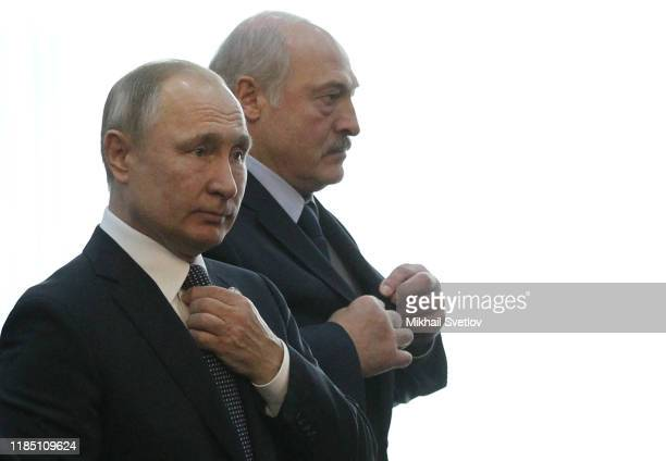 Russian President Vladimir Putin and Belarussian President Alexander Lukashenko enter the hall during the Collective Security Treaty Organization...