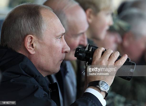 Russian President Vladimir Putin and Belarussian President Alexander Lukashenko watch joint Russian-Belarussian military exercises at the polygon on...
