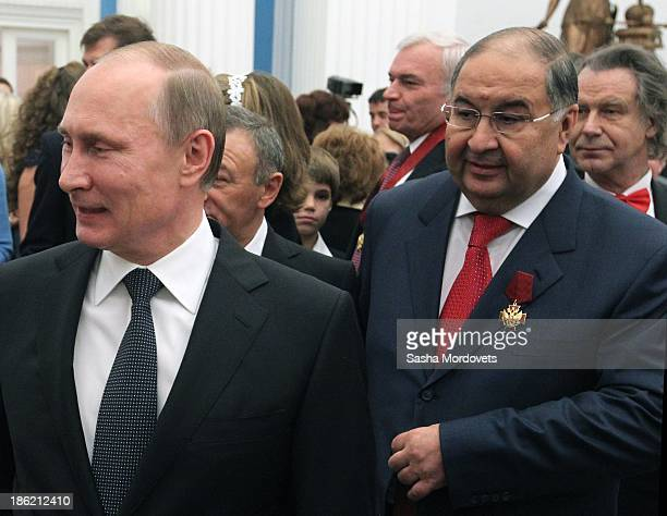 Russian President Vladimir Putin and billionaire Alisher Usmanov attend an awards ceremony at the Kremlin October 29 2013 in Moscow Russia Putin...