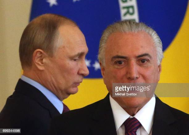 Russian President Vladimir Putin and Brazilian President Michel Temer arrive to their meeting at the Grand Kremlin Palace in Moscow Russia June2017...