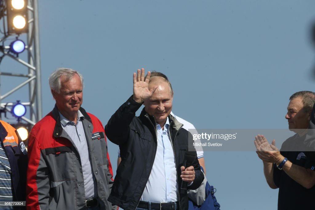 Russian President Vladimir Putin (C) and businessman Arkady Rotenberg (R) attend the opening ceremony of the Kerch Strait Bridge on May 15, 2018 in Kirch, Crimea. President Vladimir Putin is visiting the Crimea today, to open a newly built bridge from Taman peninsula of Krasnodar region of Russia to Crimea's Kerch peninsula. Crimea is a disputed territory annexed by Russia in 2014.
