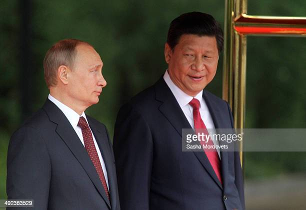 Russian President Vladimir Putin and Chinese President Xi Jingping attend a welcoming ceremony on May 20, 2014 in Shanghai, China. Putin is having a...