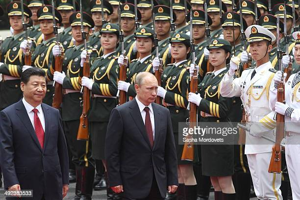 Russian President Vladimir Putin and Chinese President Xi Jingping attend a welcoming ceremony on May 20 2014 in Shanghai China Putin is having a two...