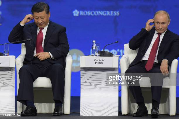 Russian President Vladimir Putin and Chinese President Xi Jinping attend a plenary session of the St Petersburg International Economic Forum in Saint...