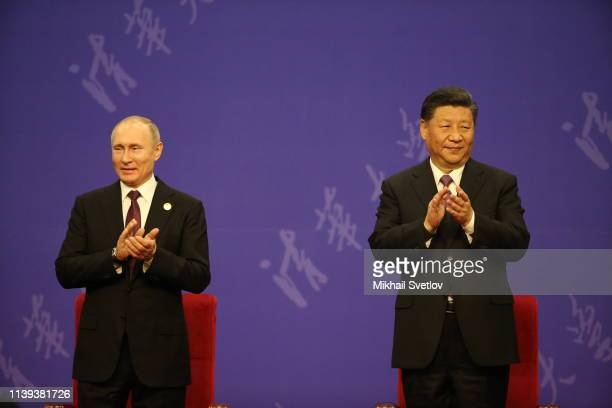 Russian President Vladimir Putin and Chinese President Xi Jinping attend the awarding ceremony in the Xingua University on April 26 2019 in Beijing...