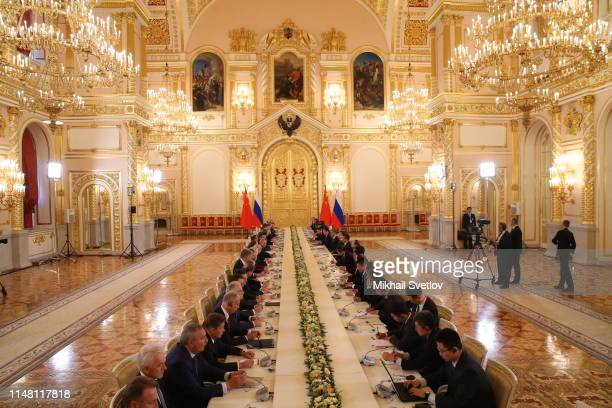 Russian President Vladimir Putin and Chinese President Xi Jinping attend the extended meeting at the Grand Kremlin Palace in Moscow, Russia,, June...