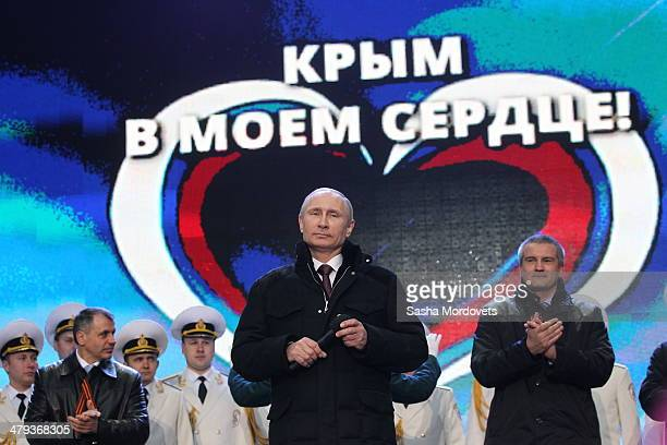 Russian President Vladimir Putin and Crimean Prime Minister Sergei Aksyonov attend a rally at Red Square on March 18, 2014 in Moscow, Russia....