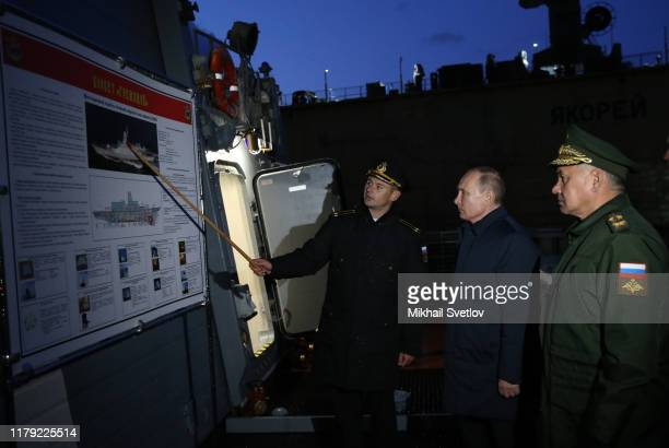 Russian President Vladimir Putin and Defence Minisre Sergei Shoigu observe a Steregushchiyclass corvete Gremyashchiy of Russian military fleeet in...