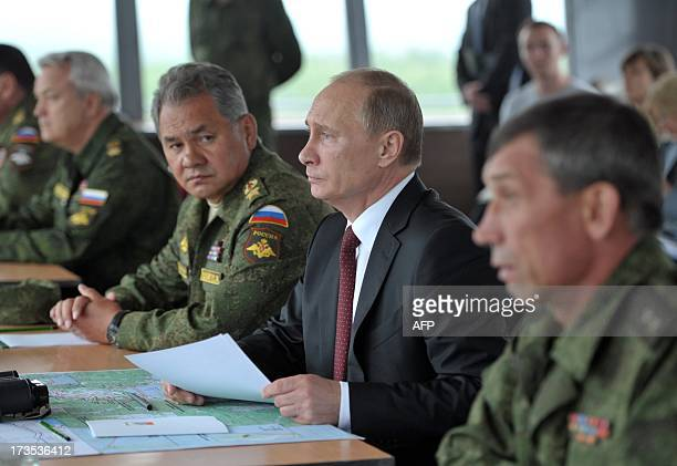 Russian President Vladimir Putin and Defence Minister Sergei Shoigu inspect Russian Army's and Naval military exercises in Pacific Ocean not far from...