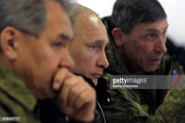 Russian President Vladimir Putin and Defence Minister Sergei Shoigu watch a military exericises at Kamenka polygon on March 3, 2014 near Saint...