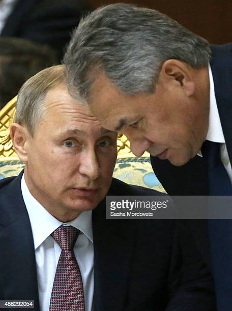 Russian President Vladimir Putin and Defence Minister Sergei Shoigu attend the Collective Security Treaty Organisation in Dushanbe Tajikistan...