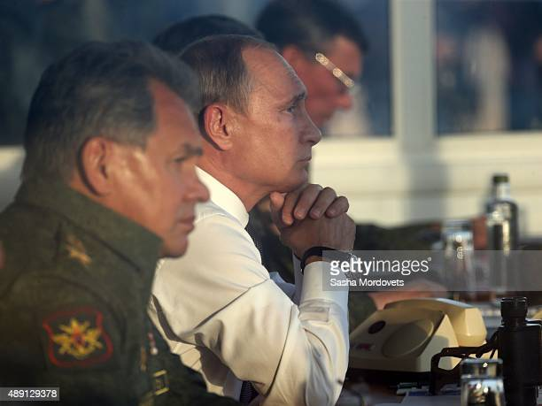Russian President Vladimir Putin and Defense Minister Sergei Shoigu are watching Russias large-scale Center-2015 military exercises at Donguzsky...