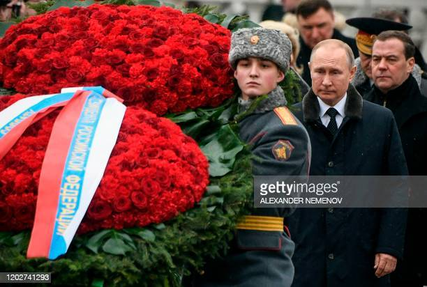 Russian President Vladimir Putin and Deputy Head of Russia's Security Counsil Dmitry Medvedev attend a wreath-laying ceremony at the Tomb of the...